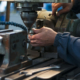 Man operating mill wrench on bench freepoint technologies