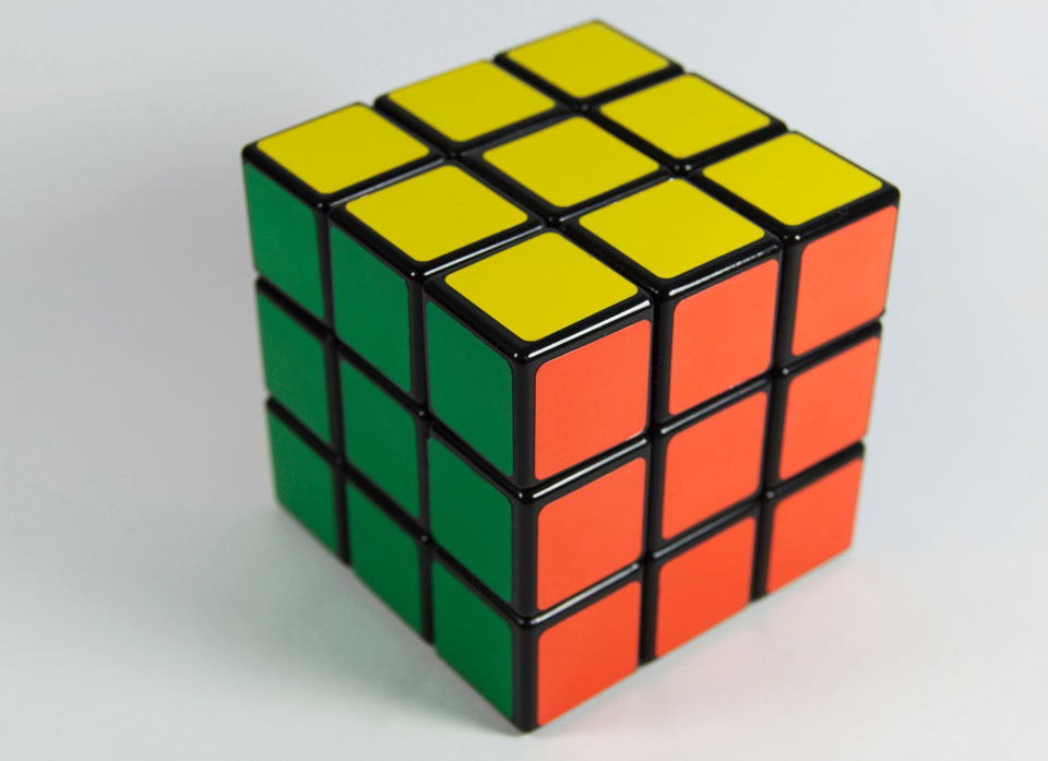 solved rubiks cube grey background freepoint technologies