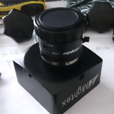 camera lens on black plastic box mightex tools in background freepoint technologies