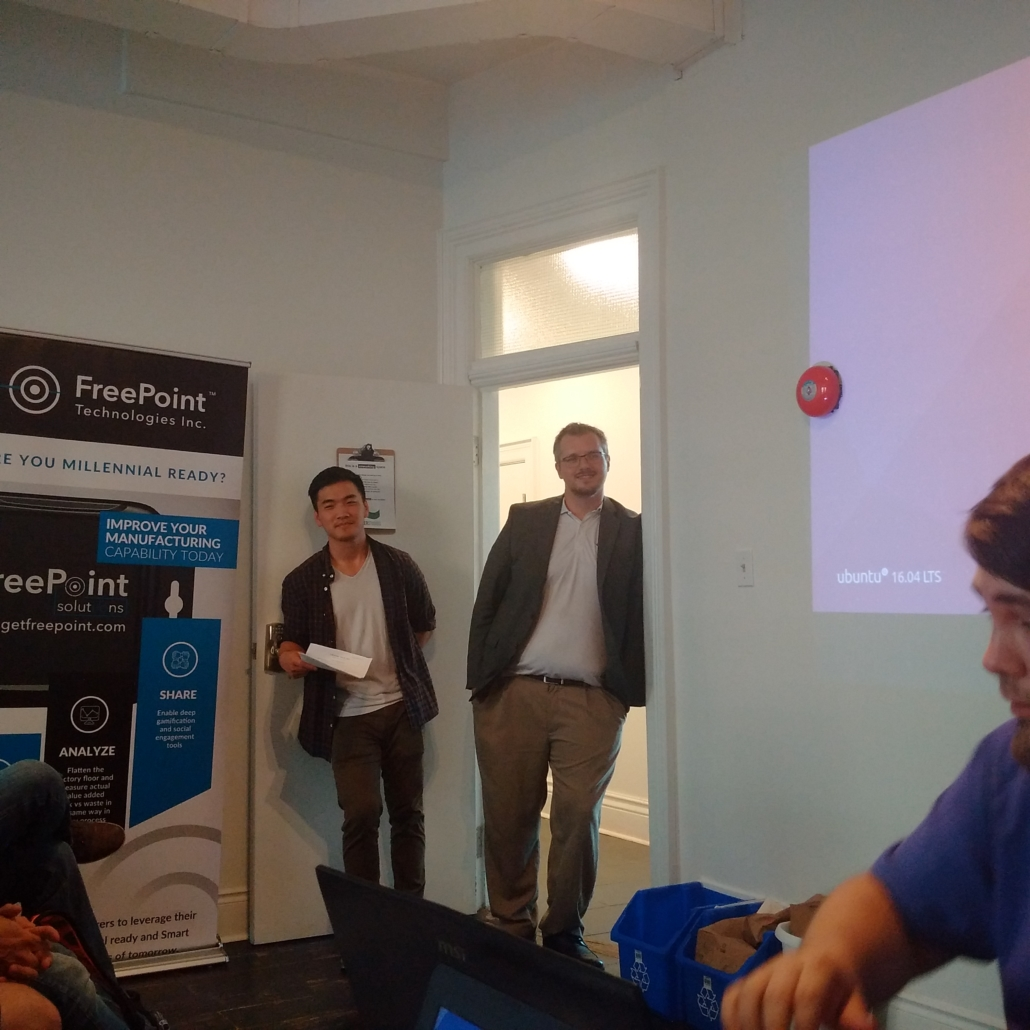 presenter loading ubuntu on projector men standing in door watching freepoint technologies