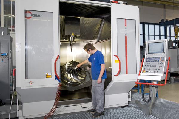 man looking at large turbine sliding doors testing environment control panel freepoint technologies