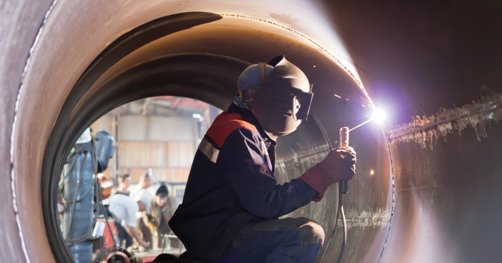 welder closing seams in pipe from inside at factory freepoint technologies