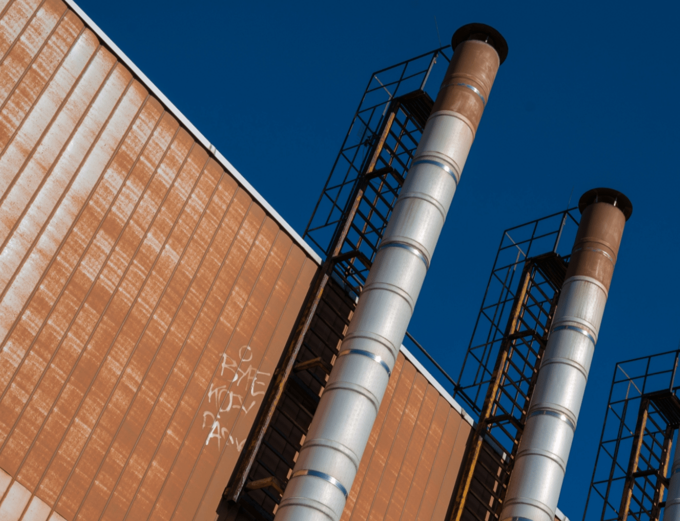smoke stacks factory blue sky freepoint technologies ladder