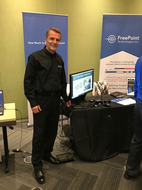 freepoint technologies president booth trade show posing display