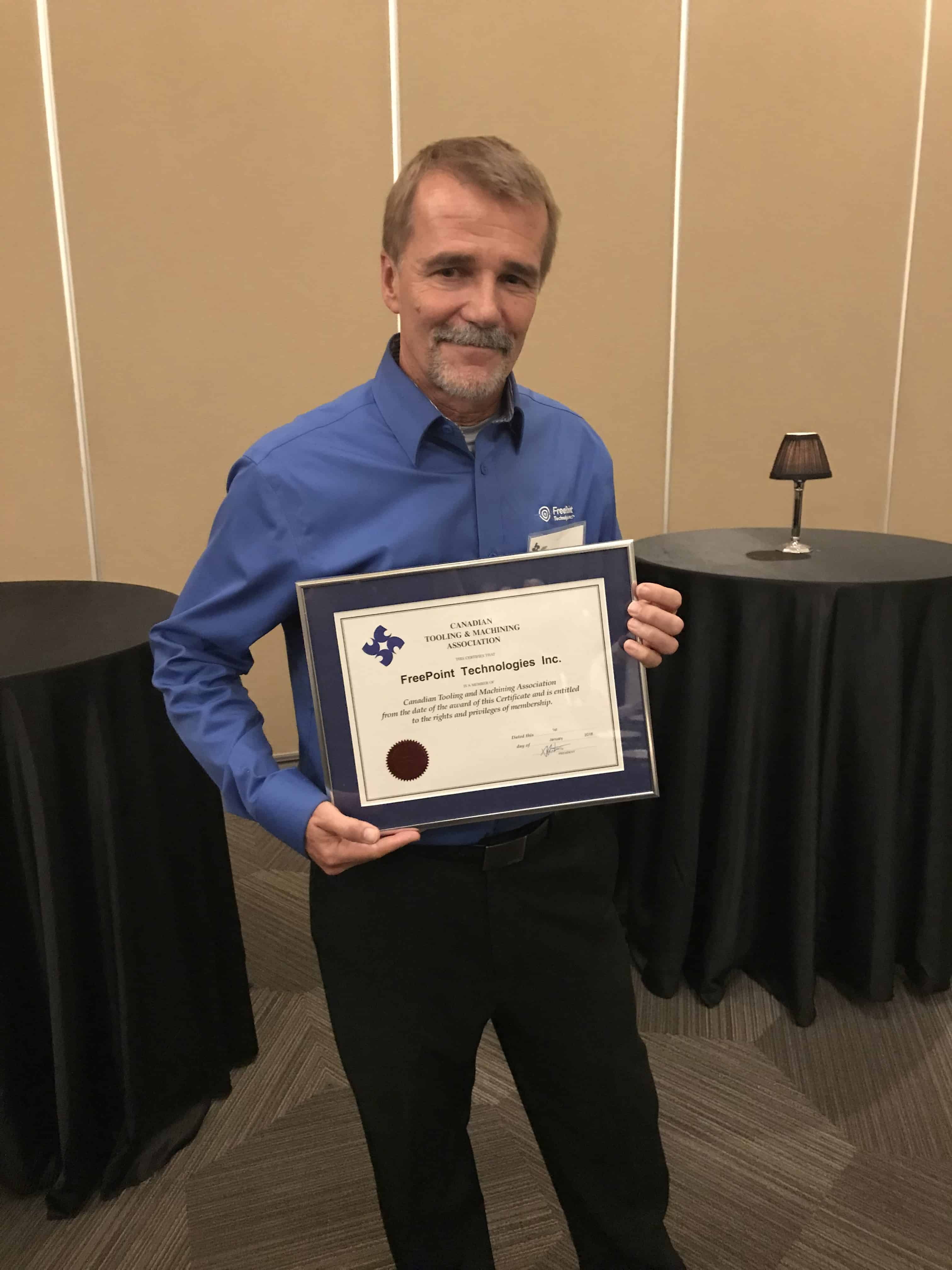 paul hogendoorn accepting plaque for cmta membership blog image