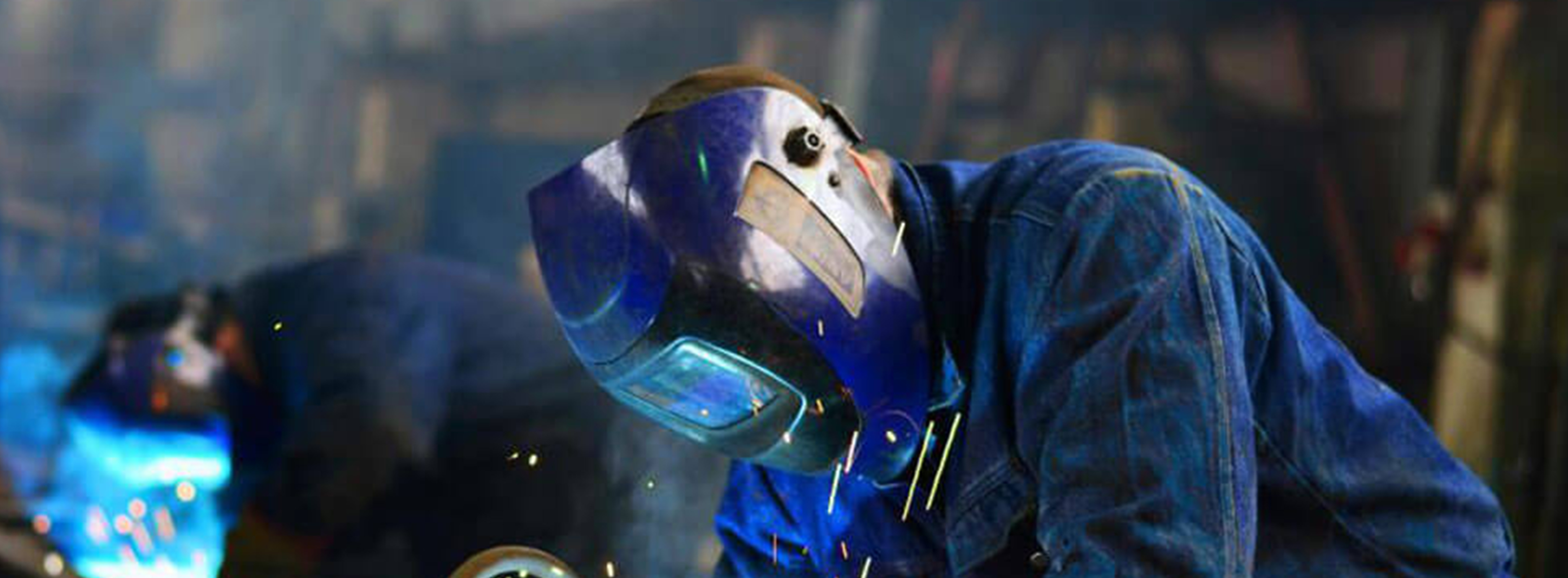 Welder with mask on